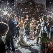 Premier Wedding Entertainment Confetti falling over bride and groom